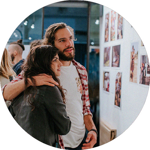Couple looking at art at a Jews for Jesus art event