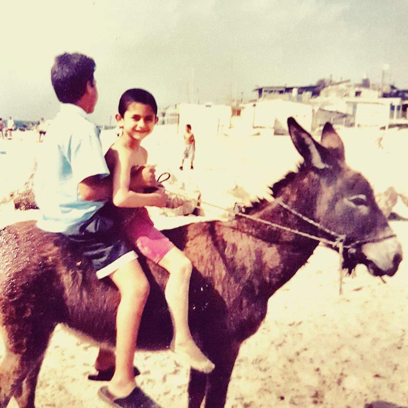 Sahar with brother riding a donkey