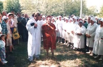 Sarah praying before being baptized in water